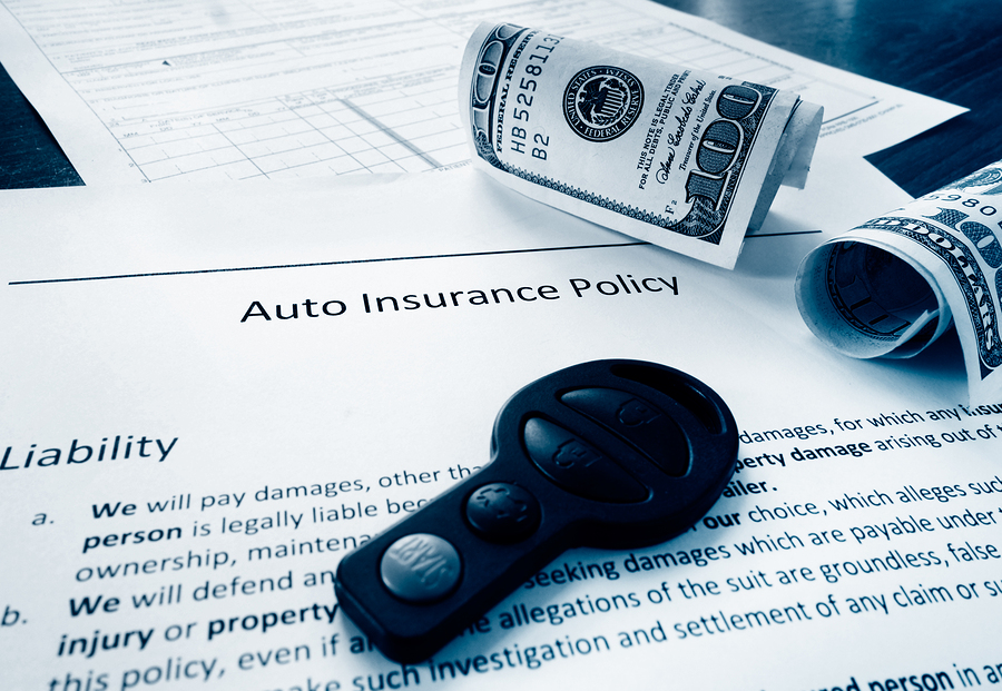 Los Angeles personal injury attorney - Auto insurance policy with cash and car key