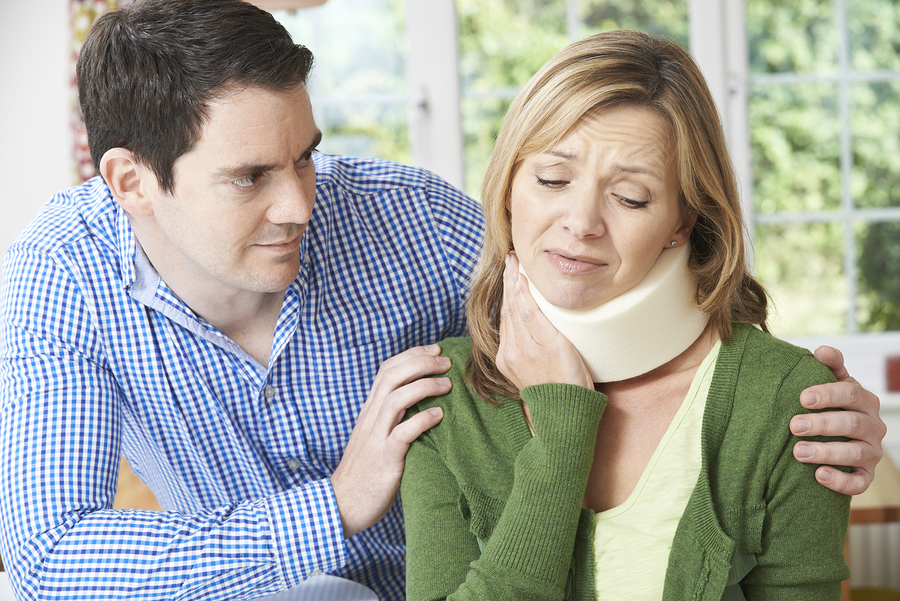 Los Angeles personal injury lawyer \ Husband Comforting Wife Suffering With Neck Injury