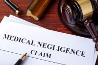 Medical Negligence claim and gavel on a table.