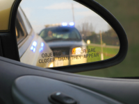 cop-in-back-mirror