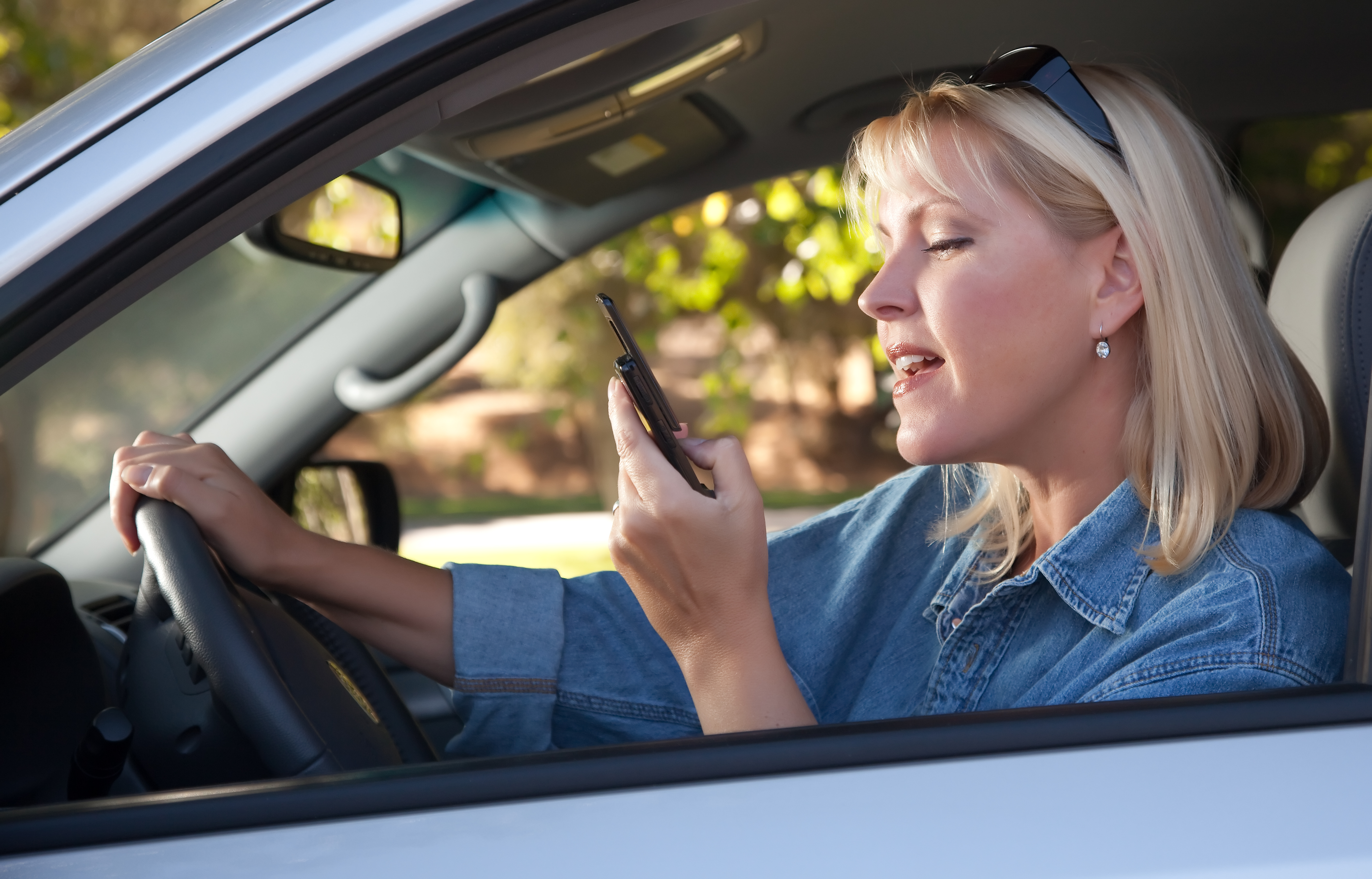 Woman Text Messaging While Driving