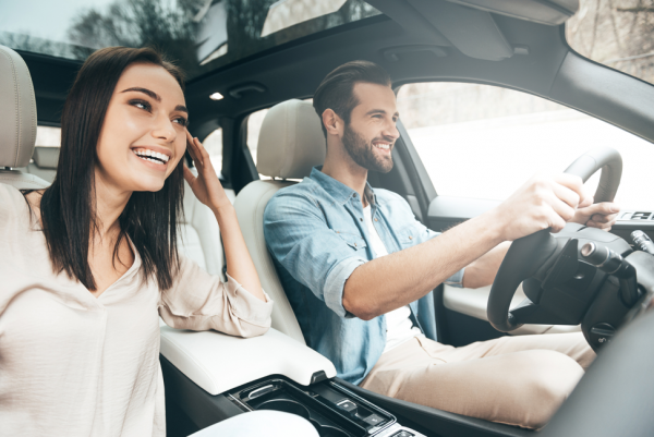 driving with smiling passenger