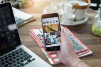 browsing instagram on phone at desk