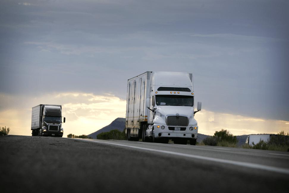 semi trucks driving on the road