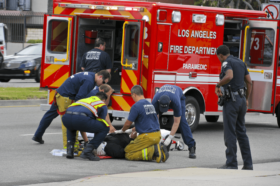 firemen helping injured victim