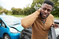 hurt-man-rubbing-neck-car-accident