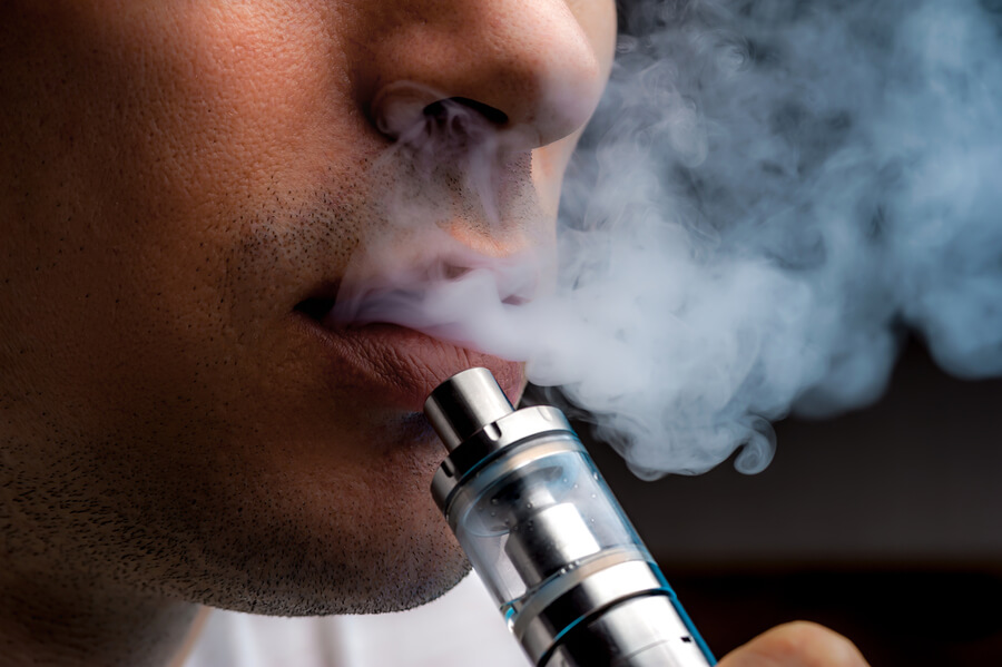 man vaping with e-cigarette