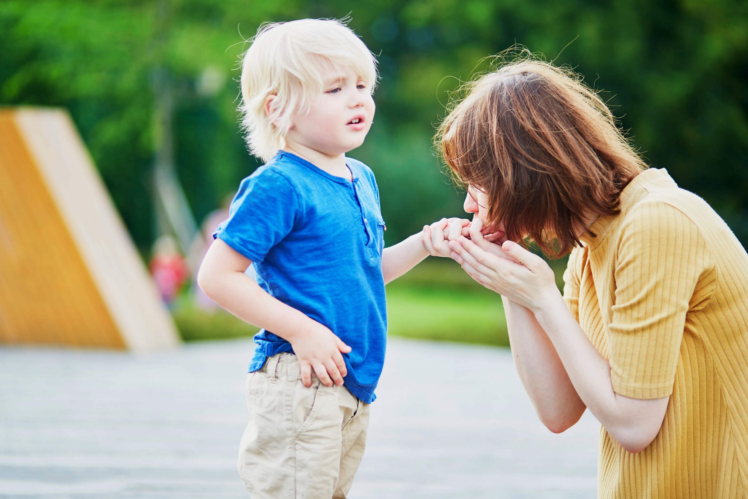 Mother-Comforting-Her-Injured-Son-At-playground