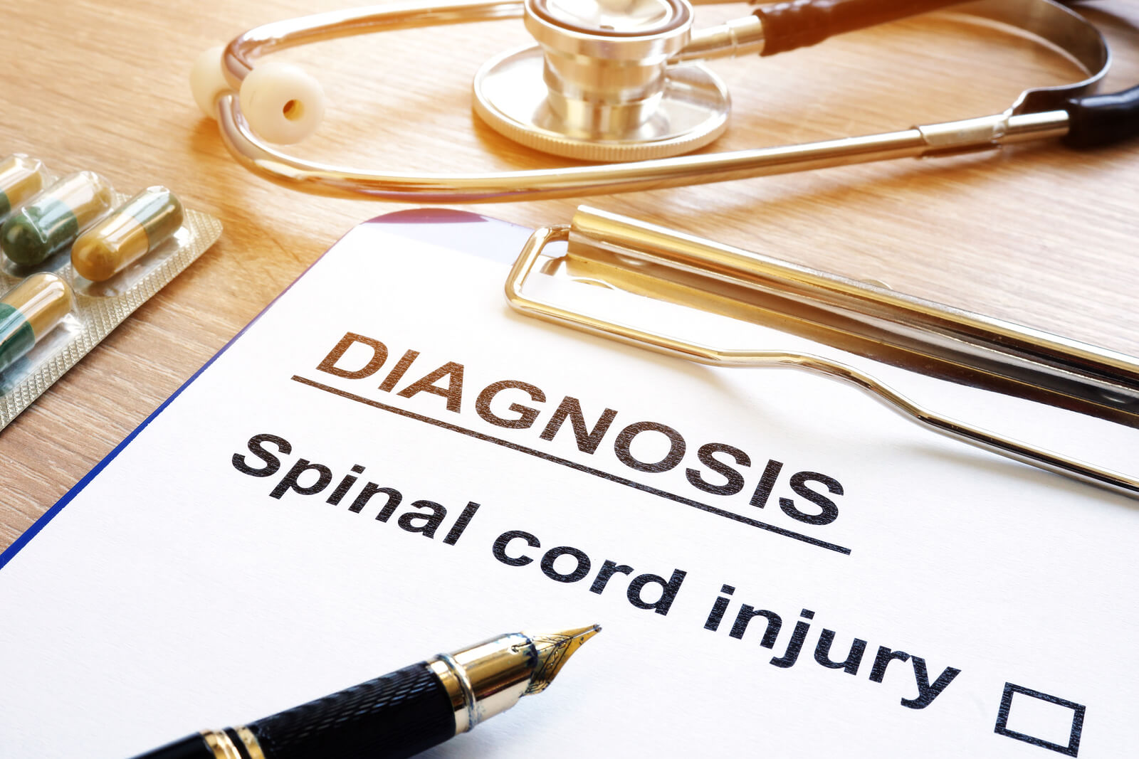 Spinal-Cord-Injury-Diagnosis-on-clipboard-with-medication