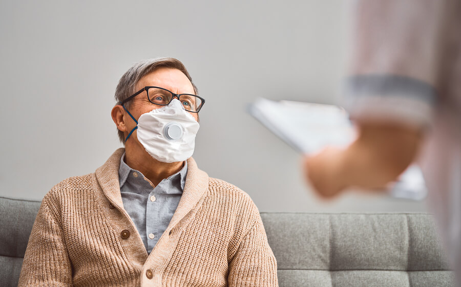 Doctor-and-senior-man-wearing-mask-nursing-home