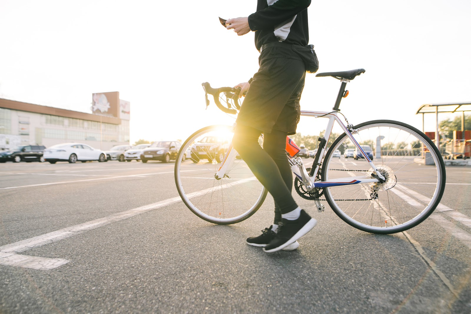Male-Cyclist-in-street-with-bicycle