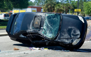 Traffic-Accident-Resulting-in-a-Crushed-Black-Car