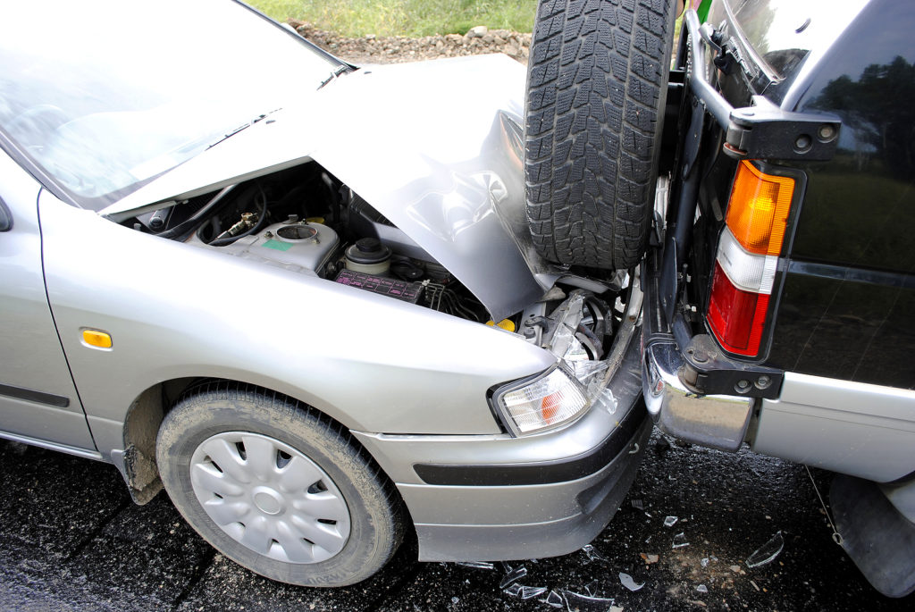 Car-Accident-with-Silver-Car-Hitting-Dark-Car-on-Highway