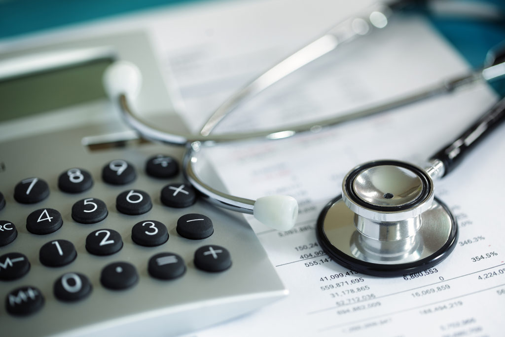 Calculator-and-Stethoscope-on-Financial-Statement