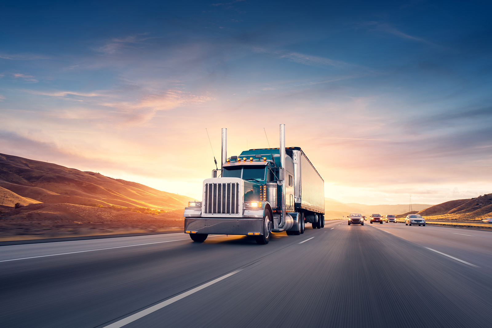 Truck-Driving-on-Freeway-at-Sunset