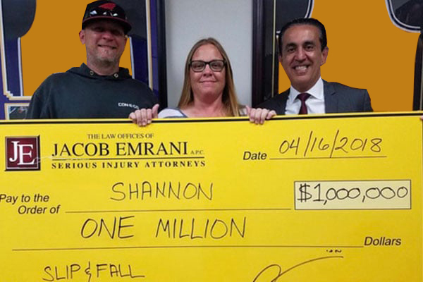 Shannon and Jacob with Settlement Check